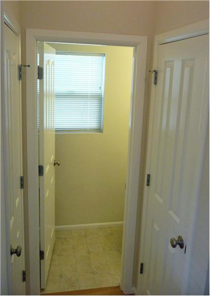 Powder room off entry along with coat closet and linen closet.