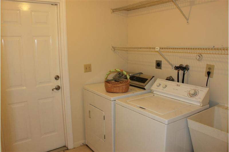 Laundry Room with door to outside
