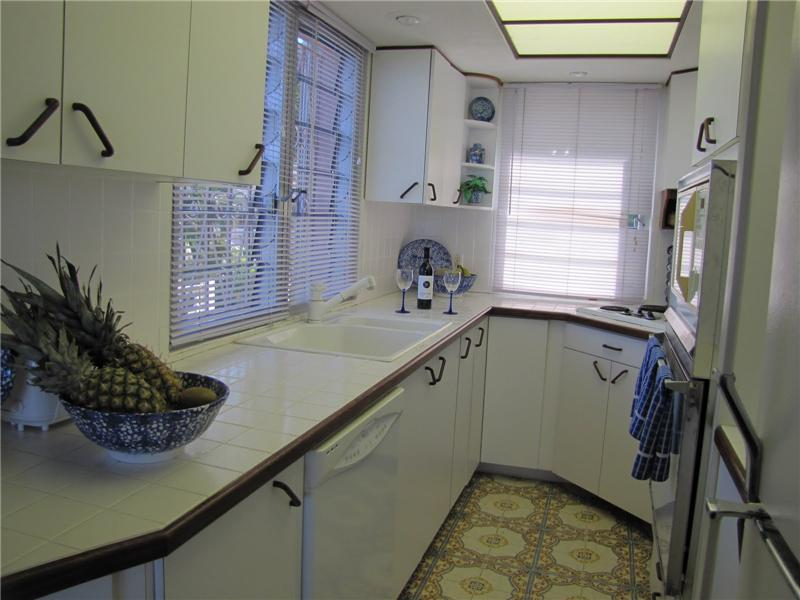Ample Kitchen Cabinets & Counter Space