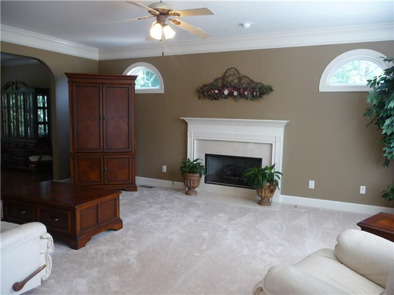 Greatroom has woodburning fireplace (currently using gaslogs), pretty crown and  molding and arched windows.
