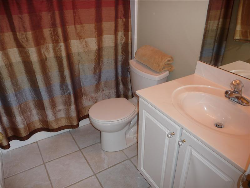 Full bath on level 2 has tile floors and a tub/shower combo.