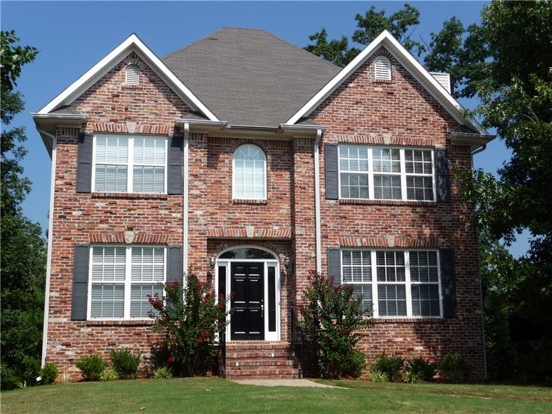 2 story brick/vinyl has colorful crepe myrtles blooming in summer months and white azaleas in the spring.