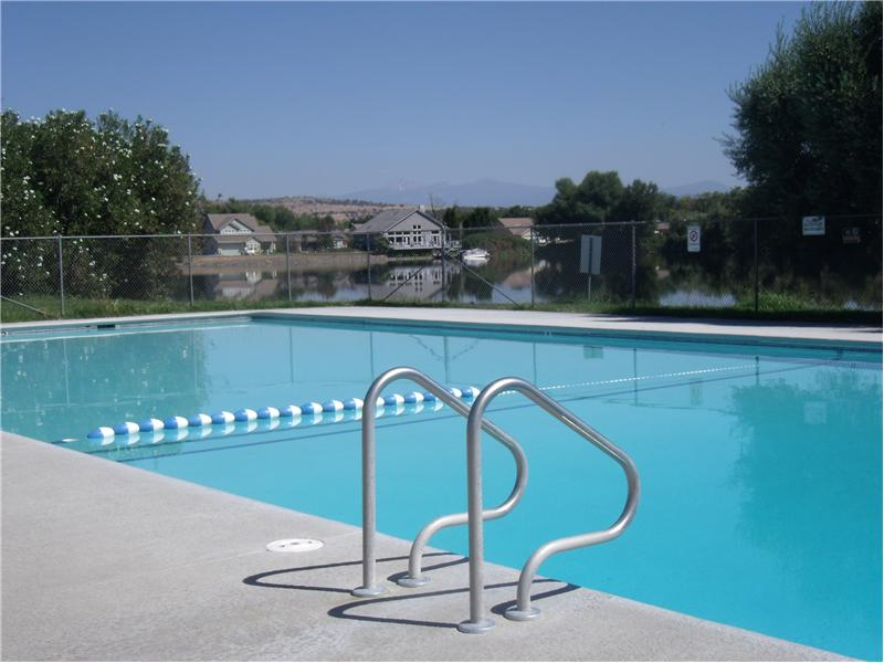 Community Pool With Lake View