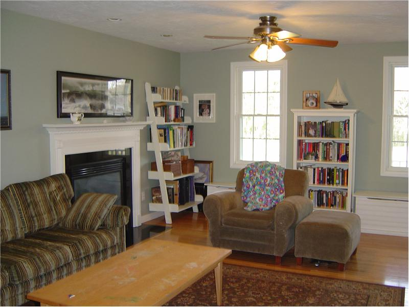 Front to back livingroom with fireplace