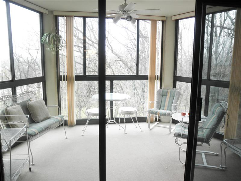 Glass-enclosed sunroom