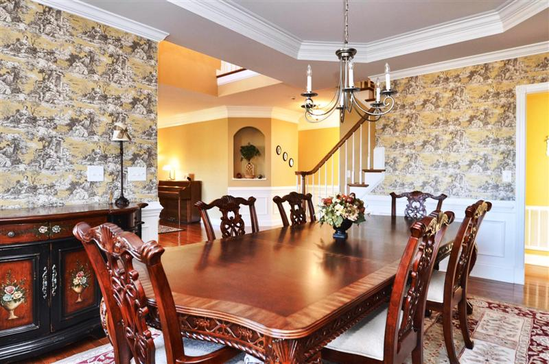 Formal dining room has extensive millwork