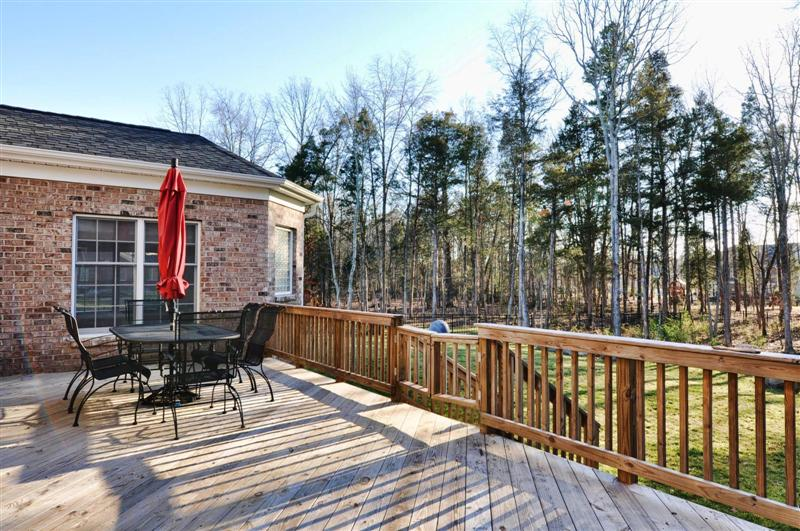 Wood deck overlooks the well landscaped backyard; home is on over an acre and is in a cul-de-sac \