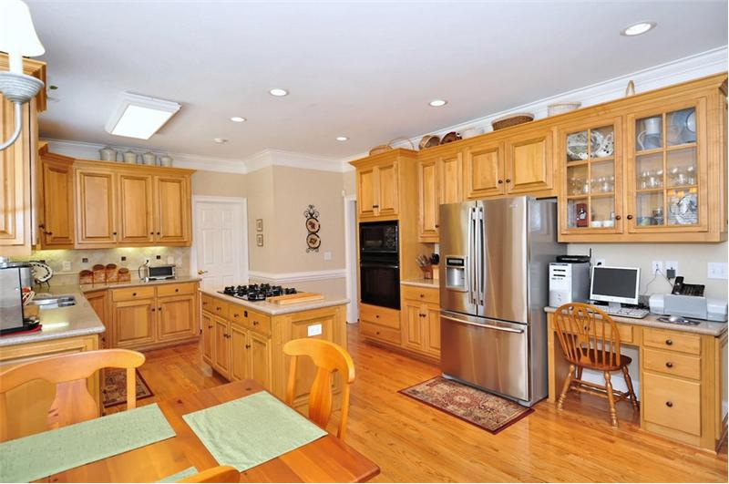 Gorgeous hardwood flooring and large pantry
