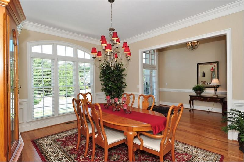 Dining room has custom millwork and moldings