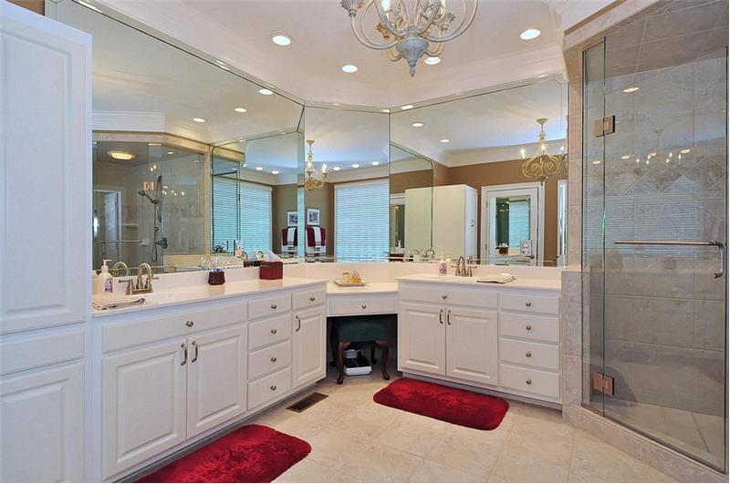 Luxury MBA has dual vanities and unique, glass enclosed walk-in shower