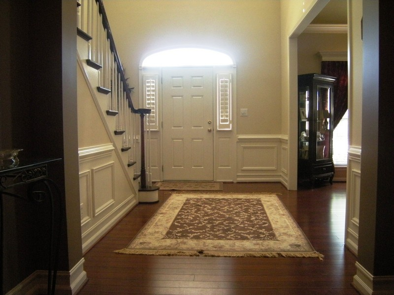 Dramatic two-story foyer upon entry