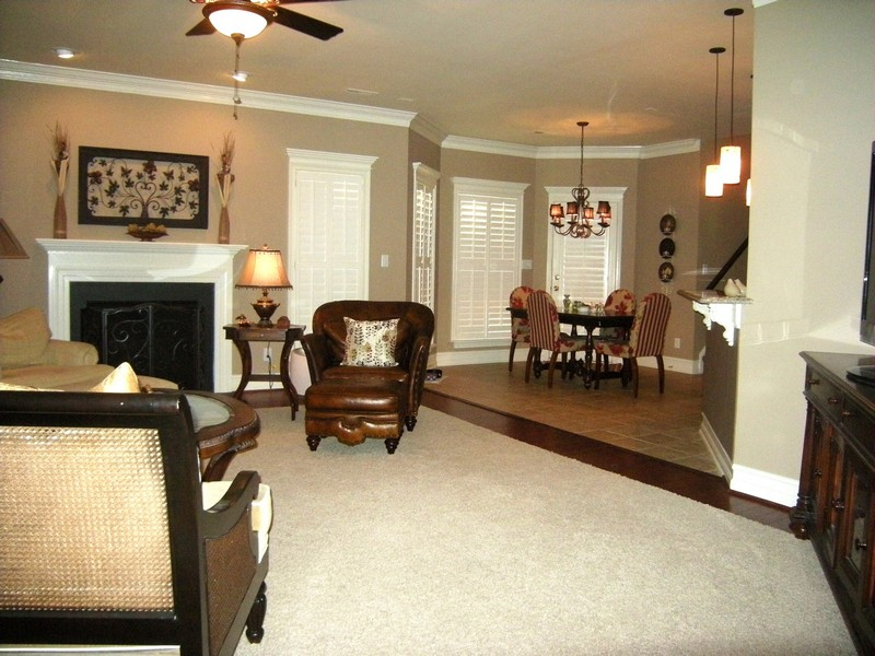 Spacious greatroom has carpet, designer paint & custom moldings