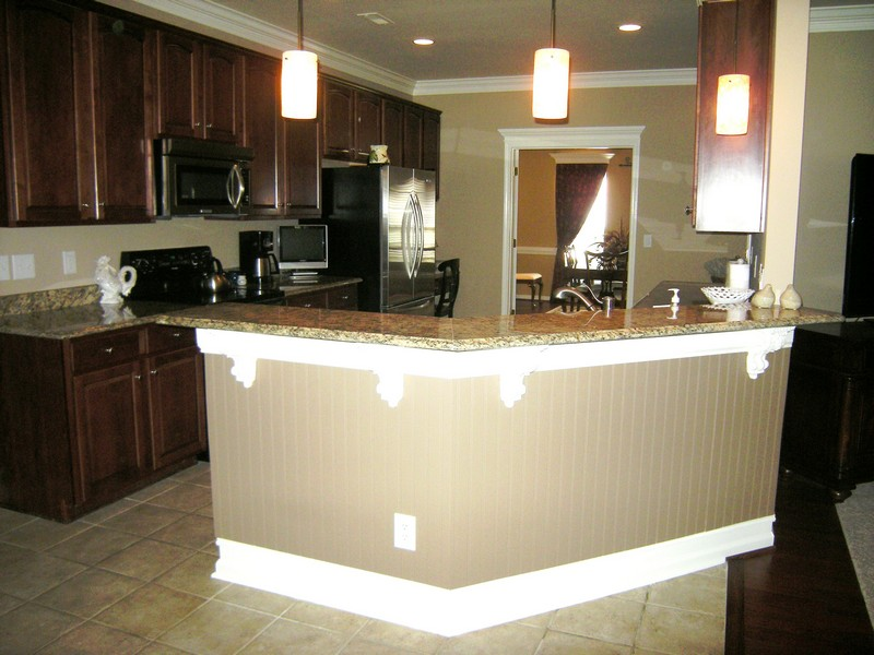Gourmet kitchen features a bar area