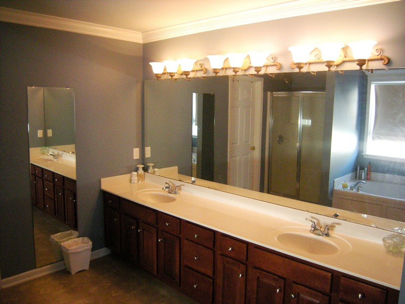 Master bathroom has a dual vanity and glass-enclosed walk-in shower