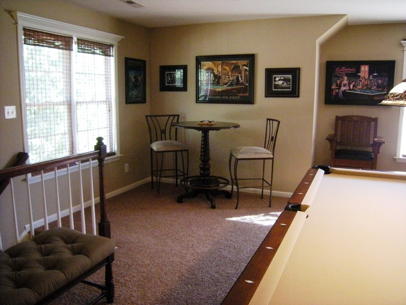 Huge recreation room has additional stairway to main level