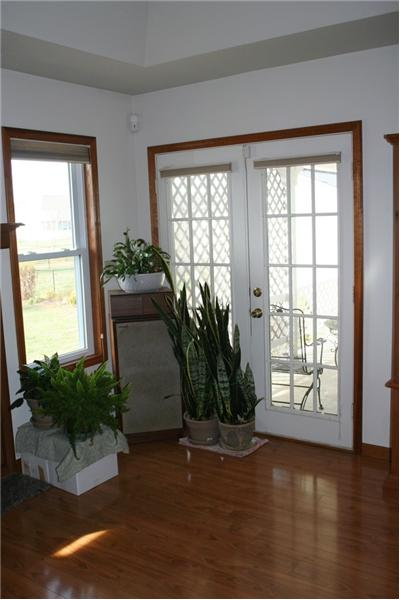 French doors leading out to private patio
