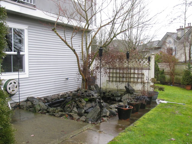 Exterior showing patio and fish pond